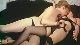 Frisky redhead lesbians are feeling up each other in retro porn